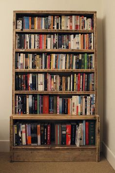 """Unkle Glen's"" bookcase, simple but delightful, 100% reclaimed timber. Measures 100cm wide x 22cm deep x 190cm high (with a deeper shelf at the base for larger books) £1150. We can do any size you require with infinite variations on number of shelves, distance between shelves etc. You tell us what you need and we will make you a drawing."