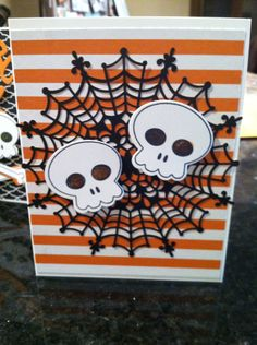 Howl-o-ween from Stampin up. And the new Happy haunting designer paper. Finishing off with spider web doilies.