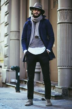 Choose a navy trenchcoat and black chinos if you're going for a neat, stylish look. Mix things up by wearing grey suede desert boots.  Shop this look for $306:  http://lookastic.com/men/looks/hat-scarf-crew-neck-sweater-longsleeve-shirt-trenchcoat-chinos-desert-boots/4541  — Grey Wool Hat  — Grey Scarf  — Grey Crew-neck Sweater  — Light Blue Longsleeve Shirt  — Navy Trenchcoat  — Black Chinos  — Grey Suede Desert Boots