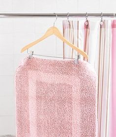 Pant Hanger as Drying Rack  Use a pant hanger to air-dry a bath mat after showering. Simply hang it over the shower curtain rod