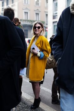 Bright yellow coat.