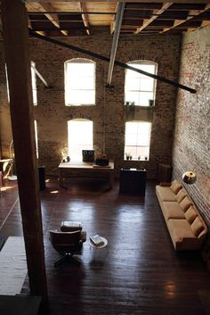 High ceilings, exposed brick, awesome furniture?! I want it all!
