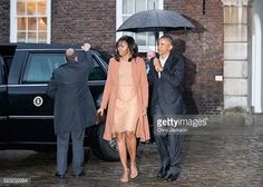 First Lady Michelle Obama and US President Barack Obama arrive for a dinner with Prince William, Duke of Cambridge, Catherine, Duchess of Cambridge and Prince Harry at Kensington Palace on April 22,...