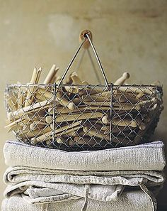 French wire basket with clothespins.