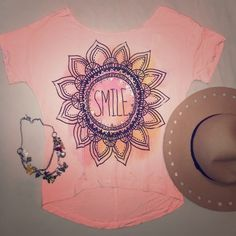"""Peach Studded Graphic Blouse Tee Super chic and fun graphic tee with the work """"smile"""" in the front with a Sun design surrounded by studs! In a very fun peachy color and an open back! Brand: Love the Classic. Brand new with tags. Size small. Made in the USA! The Classic Tops Blouses"""