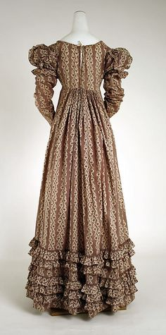 Haute Couture Victorian fashion dress gown from 1818 American 19th century. #Historical #Costume made from cotton printed with flower floral pattern. Beautiful decollete, ruched frill long sleeve with flatten at the front design emphasizes the bodice and the waistline with tier of ruffles gather pleat at the skirt hem. The back comes with gather from the waist bodice and fully flare toward the hem. #Hautecouture #Couture #Vintage #Victorian #Napoleon #Regency #Fashion