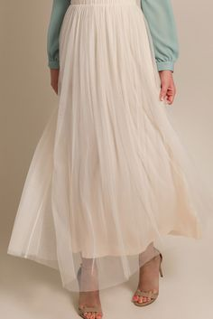 Why hello pretty! This comfortable and versatile tulle maxi skirt comes in a beautiful, soft cream color. Wear it casual...