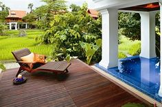 Wooden deck by the pool at Mandarin Oriental Dhara Devi in Chiang Mai Thailand