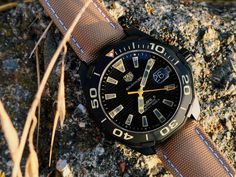 "TAG Heuer Aquaracer 300 Caliber 5 Titanium WAY208C Watch Review - by Zach Pina - See more of this rugged Aquaracer in action at aBlogtoWatch.com  - ""'One-point-five hours hiked at three miles per hour means I should be there in less than a half an hour...' I complete the mental calculation and return the TAG Heuer Aquaracer 300 to my side where it all but disappears against the canyon walls – black-on-tan livery camouflaged against the dark rushing water and sharp, sandstone crags..."""