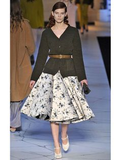 Top Looks from Europe Fall 2013 Fashion Week: Rochas | Paris - As the seasons change, this is just the kind of outfit perfect for strolling through autumn-leaved parks. The natural tones of the cardigan and floral skirt give this look a vintage meets modern hipster feel, and we love it!