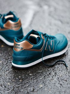 New Balance Metal Trainer at Free People Clothing Boutique in TEAL