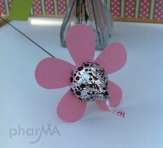 use red for valentines day and make a flower bouquet centerpiece with these.....Hershey's Kisses flowers