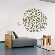 """Geometric wall decal"" - With this geometric and innovative design, Peabody Office Furniture can show their client that they are the cool, hip and yet professional. I think it would be cool to create some office furnitures that they have with the geometric shapes to create a sense of space when walking up the stairs to the connected floor."