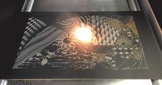Specialized 'Laser Art' System Rapidly Etches a Design onto a Chalkboard