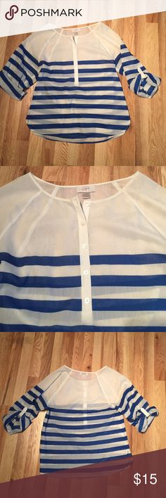 White and Blue Loft Blouse LIKE NEW! This White and blue striped blouse can be layered for any season. It is three-quarter sleeves but does have buttons as pictured so you can roll up the sleeves a bit to make them shorter. It is a roomy small, I'm typically a medium and it fits me fine. LOFT Tops Blouses