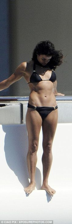 Toned: The star's abdominal muscles make another appearance as she enjoys a quick stretch...