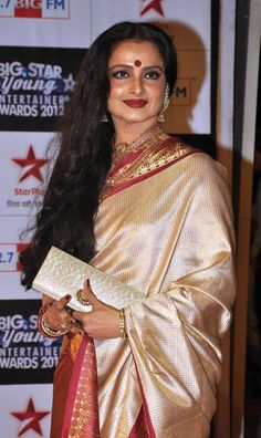 Rekha in half white kanjivaram saree with red border