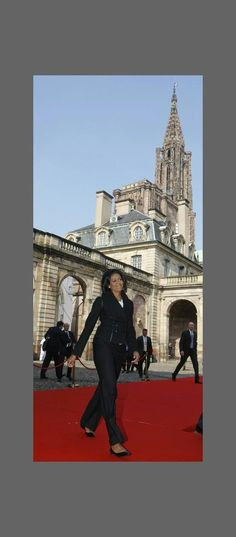 U.S. first lady Michelle Obama arrives to visit Strasbourg Cathedral (Notre-Dame de Strasbourg), April 4, 2009. The North Atlantic Treaty Organisation (NATO) military alliance is celebrating its 60th anniversary this week at a summit co-hosted by Germany and France. [Secret Service agents at right.]