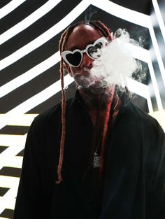 Ty Dolla Sign burns one down.