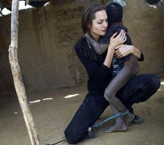 angelina jolie with little kid in Africa