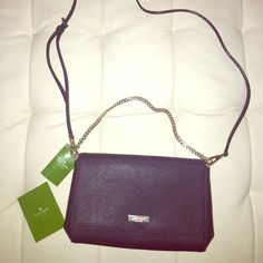 Kate Spade NEW Navy Blue Crossbody Such a beautiful bag! It is a dark blue Crossbody with a detachable strap. Comes with a gold chain that can be tucked in or used for a shoulder bag. Looks great as a crossbody with the chain on the outside as an accent too! Pretty spacious 10.5 in long and 7 in high. New with tag  I  have it in rose gold listed too. Retails 225 kate spade Bags Crossbody Bags