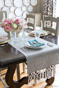 Spring tablescape with beautiful ticking stripe table runner with DIY macrame fringe added to ends!