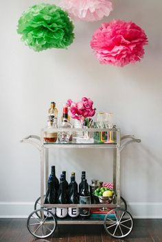 Love the paper flowers made to style this bar cart!  Books, lemons, and fresh flowers bring the perfect pops of color to any home bar!