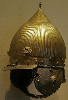 Ottoman tombak (gilded copper) chichak, a type of helmet (migfer) originally worn in the 15th-16th century by cavalry (sipahi) , consisting of a rounded bowl with ear flaps, a peak with a sliding nose guard passing through the peak, and an extension in the back to protect the neck. Various other countries used their own versions of the chichak. Met Museum.
