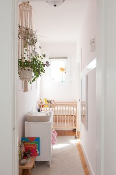 tiny nursery   small space baby room   light + bright