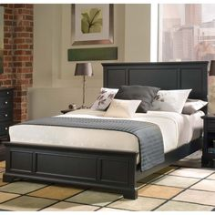 Add classic style to your bedroom with this wooden bed frame from Bedford. The black headboard, footboard and sideboards feature sleek finishes with raised panels, making the bed suitable for rooms wi
