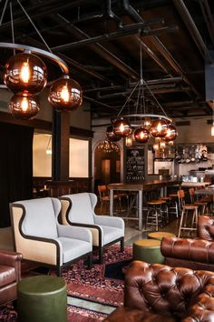 Q & C Hotel and Bar - The lobby blends concrete floors and exposed ductwork with buttery leather seating. #Jetsetter