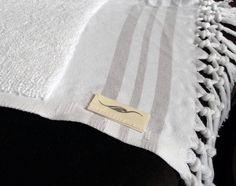 Cornucopia Magazine : A pair of luxurious hand-loomed white Turkish bath towels from Jennifer's Hamam