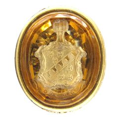 "A fine large gold seal, made circa 1800-1820 in the Regency period. It has a very detailed intaglio carved into the citrine of a crest with the word ""Spero"" meaning ""Hope"". $2850"