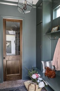 Farrow & Ball Smoke Green on walls and built-ins of a mud room by Park and Oak.