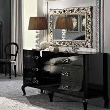Mirrored surfaces, metallic accents and warm lighting make wearing lingerie from the bedroom to the boardroom a reasonable option.   Google Image Result for http://img.homedit.com/2010/11/Drawers-in-dressing-table.jpg