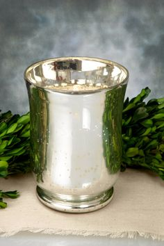 Decorate your home or special event with this stunning Mercury Glass Hurricane Vase. The classic shape and sleek, silver finish of this piece make it perfectly suited to adding sparkle and shine to any glamorous setting. Place a large pillar candle ins Mirror Centerpiece, Centerpieces, Wholesale Vases, Large Pillar Candles, Hurricane Vase, Mirror Effect, Save On Crafts, Clear Glass Vases, Reception Table