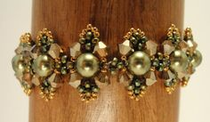 like the pattern and like the colors size 6mm pearls, 4mm bicones, 11's & 15's - tutorial available to buy