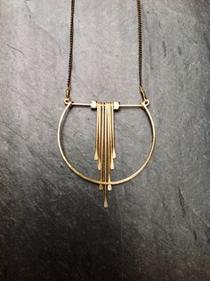 Gold Geometric Cascade Necklace, Hammered Gold, 14K Goldfill, Crescent, Portland Jewelry, Geometric, Architectural Jewelry, Necklace, Deco by LoopHandmadeJewelry on Etsy https://www.etsy.com/listing/168656121/gold-geometric-cascade-necklace-hammered