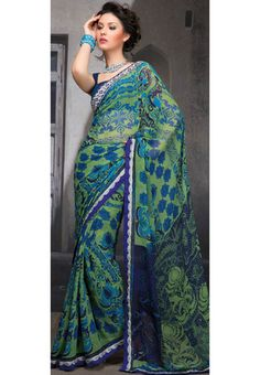 Now theres a lovely use of colour...(:  Light green and blue faux georgette floral, abstract printed and patch bordered saree. Available with matching faux georgette blouse.