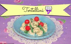 Everyone loves pasta, and Dolly makes a mean tortellini! So sink your fork into one of these truly amazing cheese filled ones covered in Dolly's house basil cream sauce and topped with cherry tomatoes and green beans, and you won't be sorry you did!