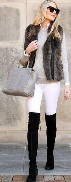 White pants,  neutral sweater, faux fur vest, black over the knee boots .