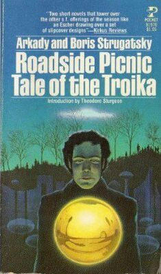 """Roadside Picnic; Tale of the Troika, by Arkady and Boris Strugatski. """"A short novel of Soviet science fiction about an alternate history where alien visitors landed on earth and promptly left, and now men risk their lives exploring the sites of their arrival to scavenge rare devices.""""  ~Robert B."""
