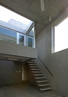Concrete homes patterned with formwork holes by atelier HAKO architects