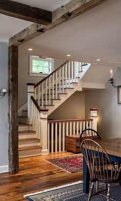 Good idea for a blend of prim and cottage.....beams and winding stairs.