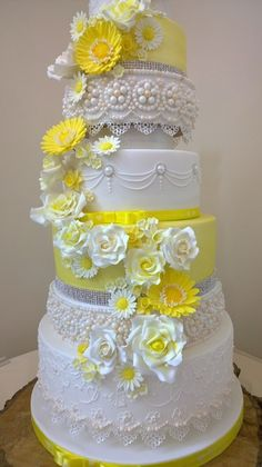 lemon Yellow flower cascade wedding cake. Lace, pearls, hand pipping,  elegant roses.  Beautiful Wedding Cakes made to order in Swansea and South Wales. Custom made design to your specific needs. Looking elegant and tasting delicious. Please contact me with any questions or to arrange a consultation.