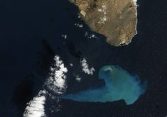 satellite view of peninsula with blue smudge in ocean