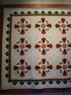 The quilting and applique is beautiful. Would be nice to make one of these one day.