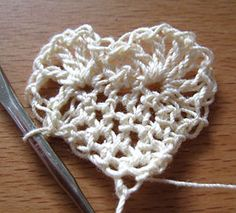 I lost the original pinner who found this while searching for the instructions. She had a lot of great crochet ideas. The basic heart.  http://www.wikihow.com/Make-a-Crochet-and-Paper-Valentine-Card