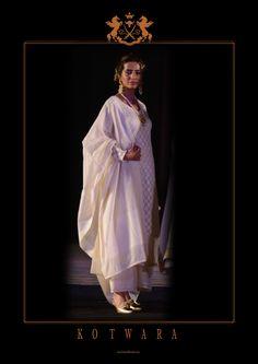 Chanderi self woven scallop hem kurta with pearl hem pyjamas and Chanderi self woven dupatta. Kotwara by Meera and Muzaffar Ali.