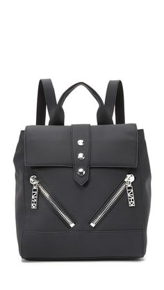 A boxy KENZO backpack with diagonal zip pockets and logo-embossed studs in front. Snap-tab gussets. Top flap, inset top zip and lined, 2-pocket interior. Locker loop and adjustable shoulder straps. Dust bag included.